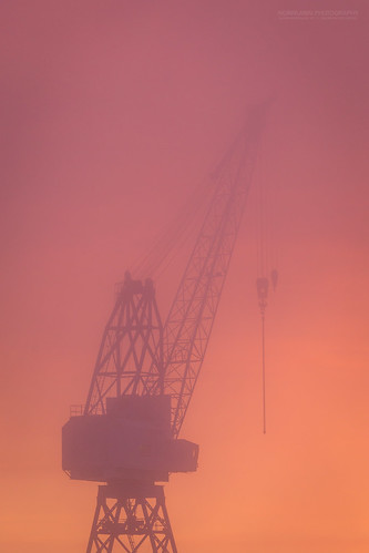 brygga fog kaldnes tønsberg canal crane harbor harbour industry mist orange seaside silhouette sunset vestfold norway no