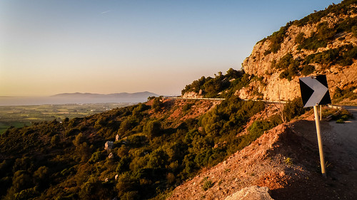 drive carefully kos greece sunset sign turn road cliff mountains orange landscape sea view trees green