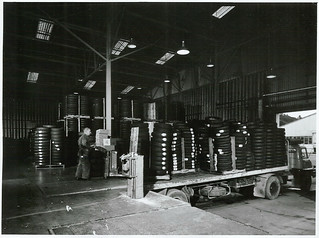 """Tyre dispatch bay"""" pallet loading on to carrier trucks, at the Dunlop Tyre Factory, Upper Hutt"""