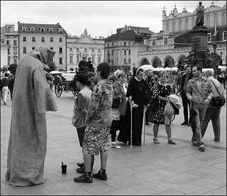 Grim Reaper and nun with crutches at Rynek Gowny, Old Town (7/11 gy69)