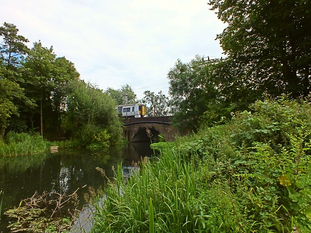 A Class 379 Electrostar speeds over a spur on the River Lea, at Broxbourne. 13 07 2014