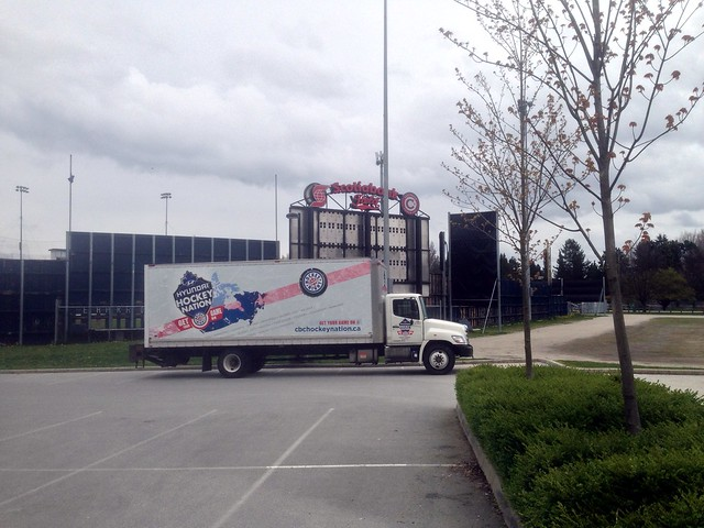 Hockey truck parked next to a baseball stadium