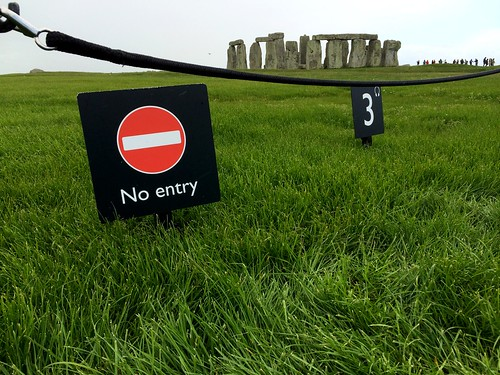 Stonehenge - sign and the stones