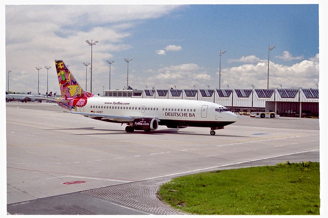 Boeing 737 (D-ADBT) from Deutsche BA (dba) with special tail design at Munich International Airport, Bavaria, Germany