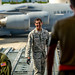 Then Tech. Sgt. Alfred Van Gieson, now Master Sgt., shares a laugh with the crew of a C-135 waiting to transfer cargo at the 48th Aerial Port Squadron, 624th Regional Support Group, Joint Base Pearl Harbor-Hickam, Oahu, Hawaii, Aug 13, 2016. Van Gieson, an Air Force reservist, is a veteran of Operation Iraqi Freedom, a world champion outrigger, or Va'a, paddler and the coach at the Leeward Kai Canoe Club in Nanakuli, Oahu, which was founded by his grandparents. (U.S. Air Force photo by J.M. Eddins Jr.)