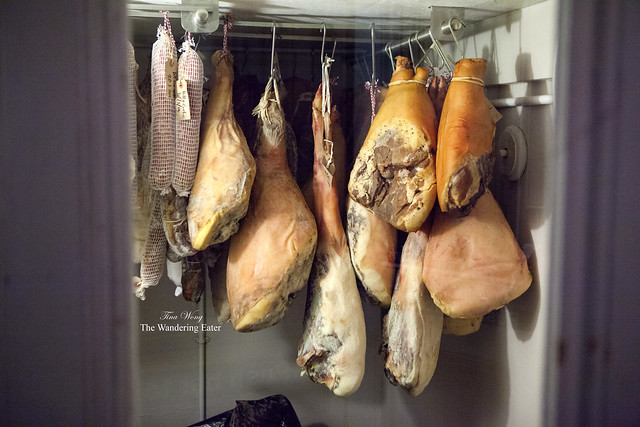 Hanging legs of house made hams and charcuterie near the entrance