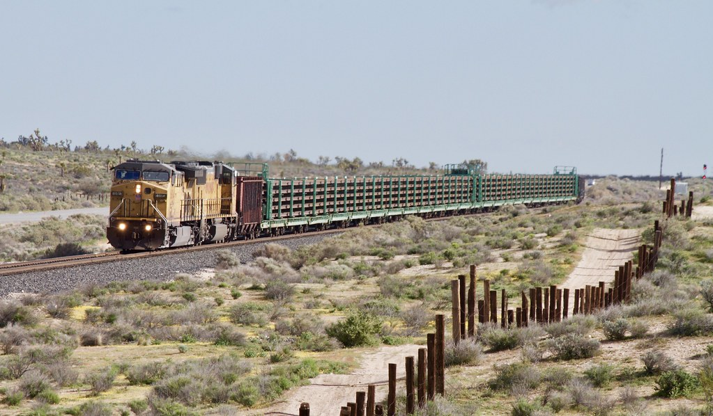 Long welded rail carrier train | Rolling along south of Moja