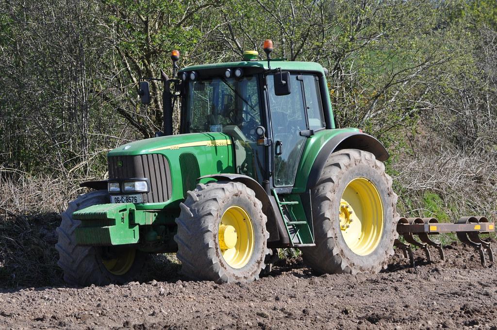 john deere 6620 tractor  cultivator  a huge word of