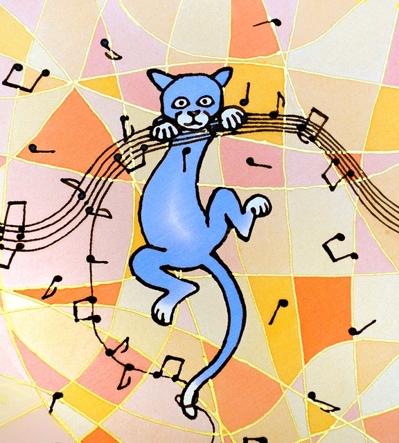 naughty cat getting into the music....
