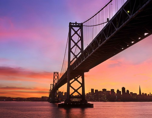 san francisco bay bridge sunset color sunrise skyline water reflection buildings west side span city under beneath sky clouds rz67 velvia provia e100 low down