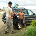 Then Tech. Sgt. Alfred Van Gieson, now Master Sgt., a reservist air transportation specialist with 48th Aerial Port Squadron, 624th Regional Support Group, greets Kexton Cafa after arriving from work for a club party at the Leeward Kai Canoe Club at Kalaianaole Beach Park in Nanakuli, Oahu, Hawaii, Aug 13, 2016. Van Gieson, an Air Force reservist, is a veteran of Operation Iraqi Freedom, a world champion outrigger, or Va'a, paddler and the coach at the canoe club, which was founded by his grandparents, where he tries to be a positive influence in the lives of local kids who hang out at the beach like he did when he was their age. (U.S. Air Force photo by J.M. Eddins Jr.)