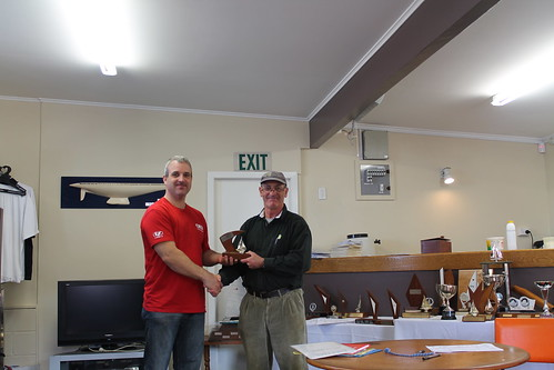 Pete Linford, winner of the Early Bird Series being presented the Secretary Senior Trophy by Will Perry | by PLSC (Panmure Lagoon Sailing Club)