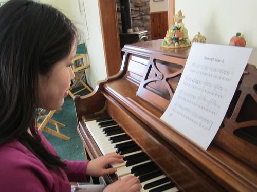 Sophia playing the piano   by Pictures by Ann