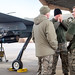 Senior Airman Jeremiah Hubbard, an MQ-9 weapons technician, and Senior Airmen Todd Creamer and Colton Tustin, MQ-9 crew chiefs, talk and try to stay warm while diagnostics are run on a Reaper remotely piloted aircraft at Holloman Air Force Base, N.M., Dec. 16, 2016. The squadron supports the 6th Reconnaissance Squadron, as well as the 9th and 29th Attack Squadrons, enabling the graduation of pilots and sensor operators in support of the Air Force's largest formal training unit. (U.S. Air Force photo by J.M. Eddins Jr.)