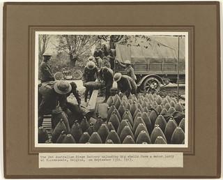 Photograph - 2nd Australian Siege Battery unloading big shells from a motor lorry, Voormezeele, Belgium