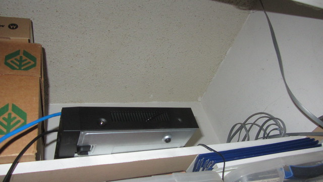 IMG_1936 Lorex security DVR on closet shelf where cables will drop in