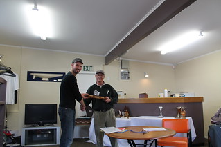 Andrew Dare being presented the Barbecue Trophy for most improved Senior Sailor | by PLSC (Panmure Lagoon Sailing Club)