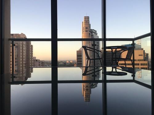 haymarket city coffeetable appleiphone6 apartment buildings reflection sunrise newsouthwales nsw australia sydney