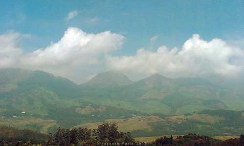 clouds cloudscape tea sy green lush forest gardens landscape nature shades shadows beauty mountains hills bright lit