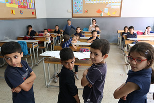 Syrian refugee students listen to their school teacher during math classes | by World Bank Photo Collection
