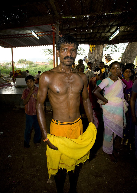 Indian Soaked Man With A Mustache Posing Shirtless At A Fire Walking Ritual, Madurai, South India