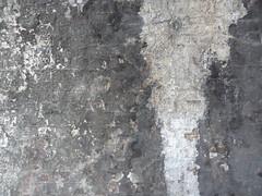 Wall of passage under railway bridge