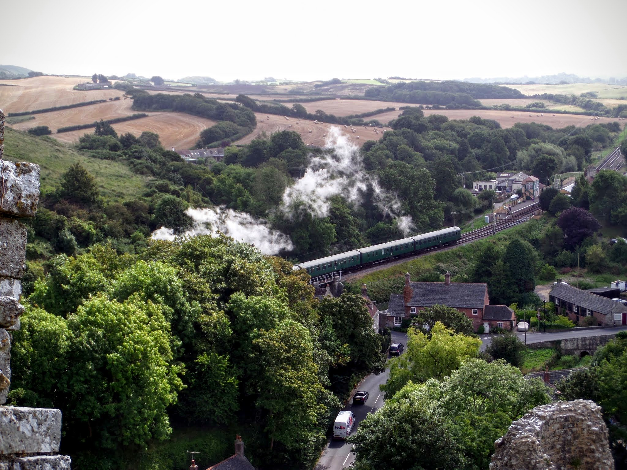 A heritage steam train from Swanage passing through Corfe Castle
