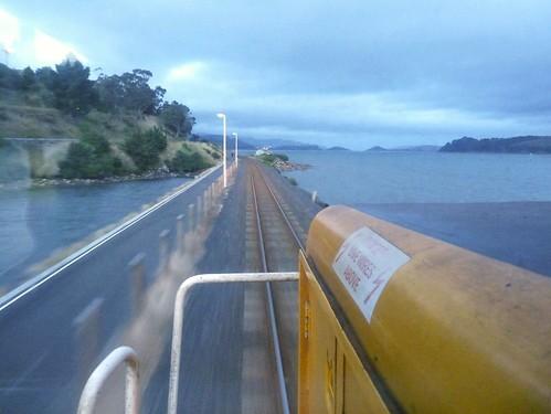 railroad newzealand summer water train evening gm diesel dusk interior cab railway loco southisland dunedin locomotive goldenhour causeway ontheline emd tranzrail cabview mainsouthline dftclass dft7132 gtl22mc