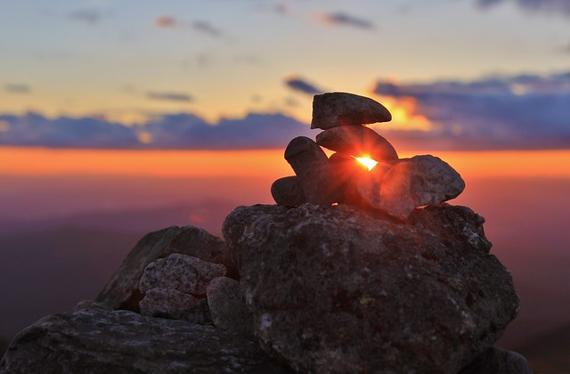 Sunset through a cairn