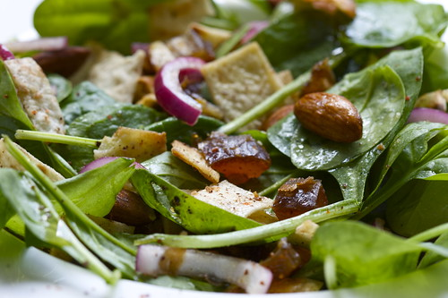 Ottolenghi's spinach salad with dates, almonds & crispy bread