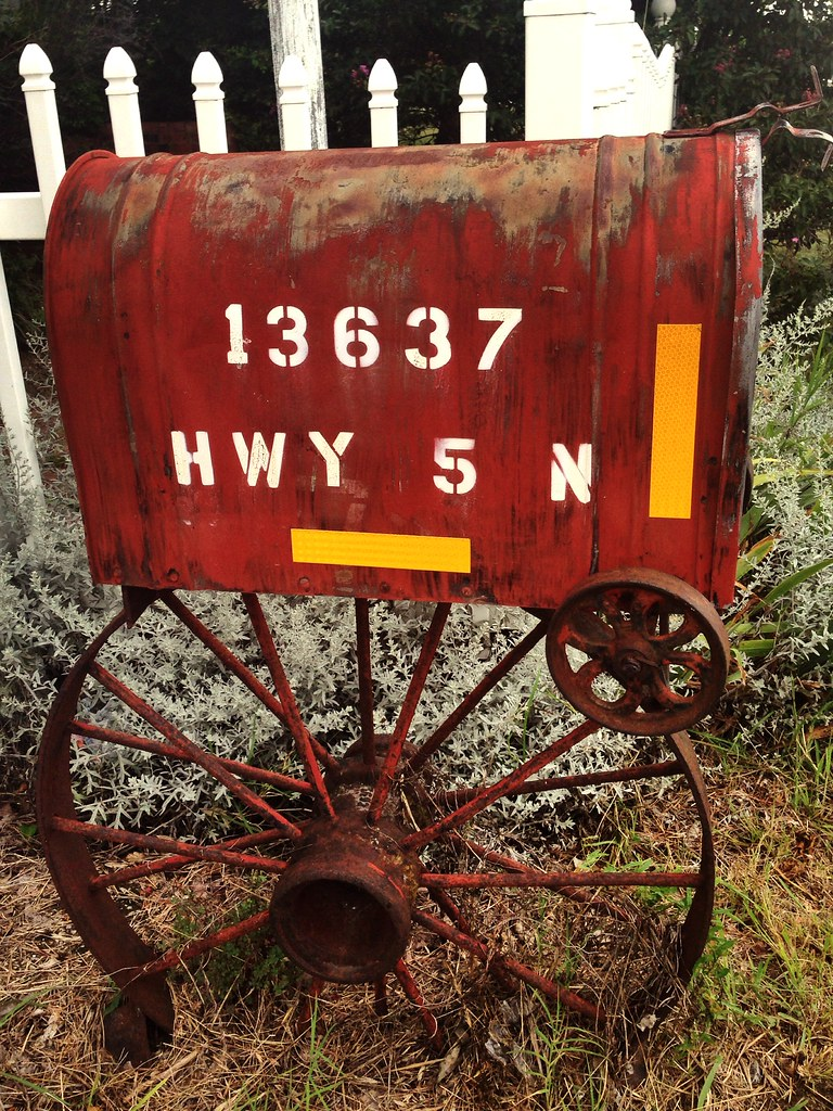 Rusty Mailbox with Wagon Wheel