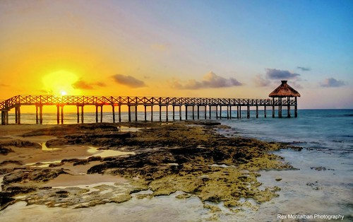 How about a sunset shot with some rocks and a pier in the foreground?