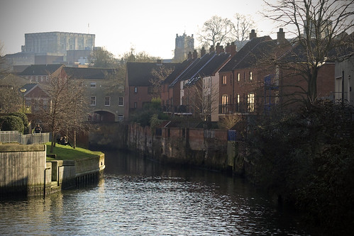 norwich river wensum castle church riverbank grass houses quayside buildings water trees anchor quay people