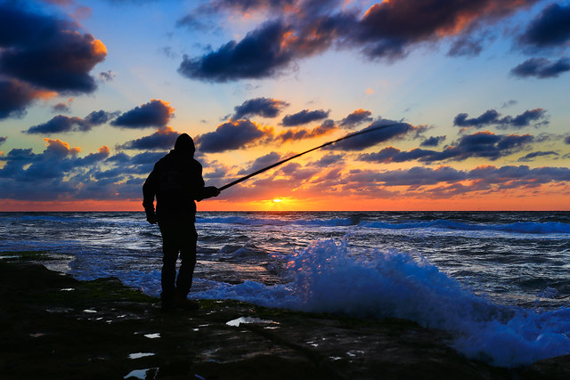 Fishing at sunset - Tel-Aviv beach