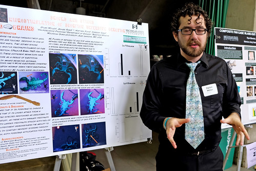 MSU student Dylan Miller explains his research about scorpion at the Summer Undergraduate Research Forum at the Breslin Center. (Photo/D.L. Turner)