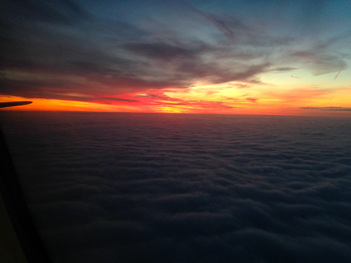 beaconsfield england unitedkingdom gb sunrise sky clouds iphone iphone5s orange red grey sun airplane window fromtheairplanewindow