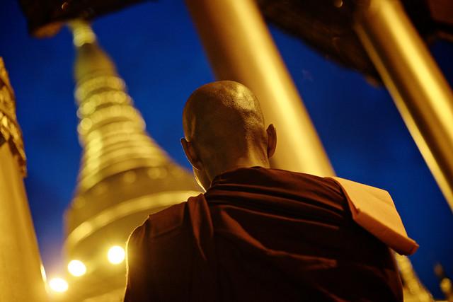 Burmese monk praying at Shwedagon Pagoda, Yangon, Burma