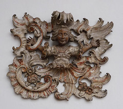 Sat, 06/04/2011 - 2:03pm - A wood carving with an angelic youth ensconced in a burst of Rococo ornament.
