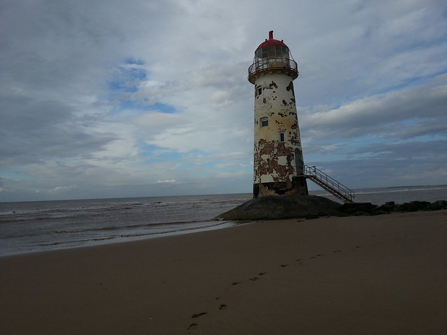 Lighthouse with tide in