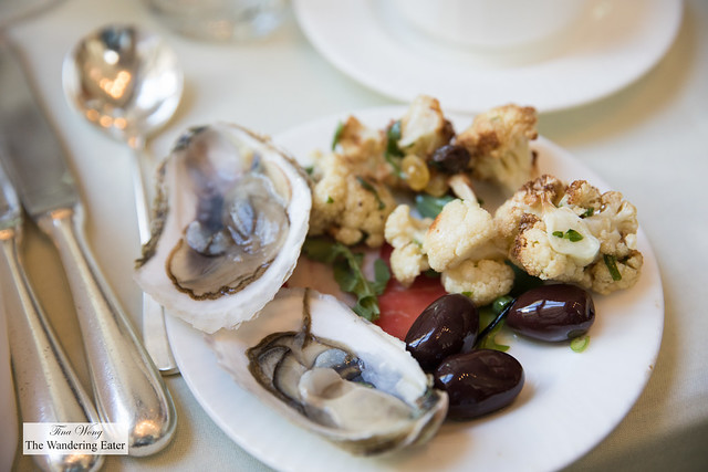 Plate of oysters, olives and roast cauliflower