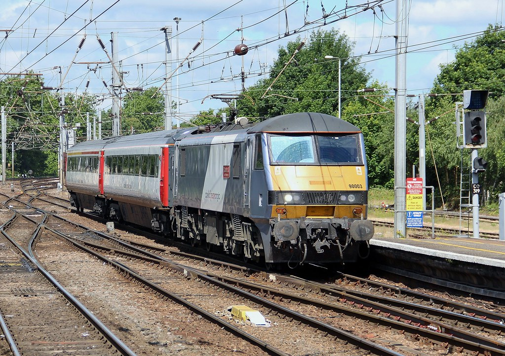 Greater Anglia Class 90 90003 passing through Ipswich with up empty stock movement, 11th. June 2014 by Crewcastrian