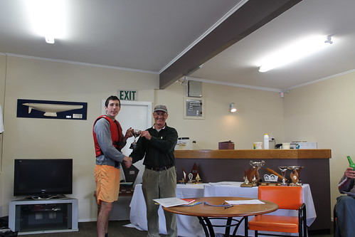 Andrew Coffin being presented the M.W.Y.C Cup - Junior  Cup by Will Perry | by PLSC (Panmure Lagoon Sailing Club)