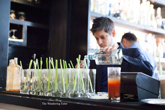 Josh cranking out the Bloody Marias (measuring shots of Olmeca Altos Blanco)