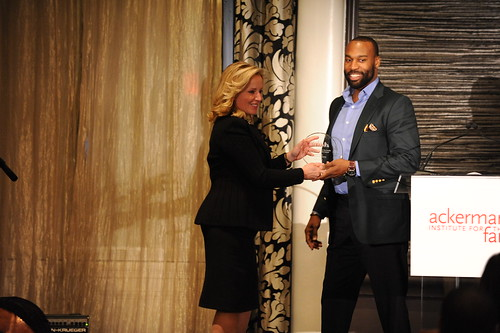 Gala Co-Chair Martha Fling presenting the Ackerman Distinguished Service Award to Baron Davis | by Moving Families Forward
