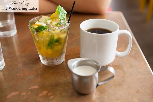 Peach Smash cocktail and mug of coffee