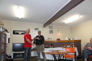Pete Linford, winner of the Sprint Race Series being presented the McCulloch Cup by Will Perry | by PLSC (Panmure Lagoon Sailing Club)