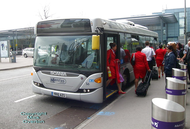 Cabincrew arrive at Heathrow Terminal 3 on Scania Omnicity YR10AZG Menzies S6