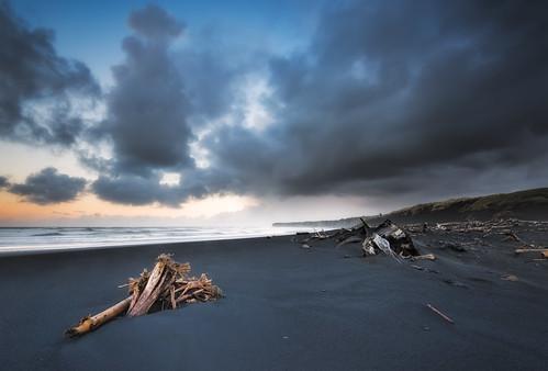 longexposure newzealand seascape weather clouds sunrise blacksand waves wideangle driftwood nz northisland westcoast wanganui taranaki earlymorninglight colourimage patea leefilters distantrain nikond800 stormymood manabay lee09nd lee06gndsoft phottixgeoone nikkor160350mmf40