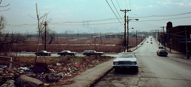 More Jersey City wanderings from back in the good old days. The Lower Manhattan skyline and the World Trade Center looms over abandoned empty fields which once housed dozens of small factories. March 1976.