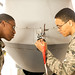 Airman 1st Class Julian Kelly and Airman 1st Class Jonathan Brewer, MQ-9 avionics technicians with the 49th Aircraft Maintenance Squadron, inspect the pitot tube and other avionics input instruments on the nose of an MQ-9 Reaper remotely piloted aircraft in a hangar at Holloman Air Force Base, N.M., Dec. 16, 2016. The squadron supports the 6th Reconnaissance Squadron, as well as the 9th and 29th Attack Squadrons, enabling the graduation of pilots and sensor operators in support of the Air Force's largest formal training unit. (U.S. Air Force photo by J.M. Eddins Jr.)